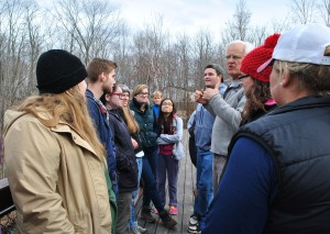 Communication students learn about dams from Tony Grassi at the Freedom Falls Mill