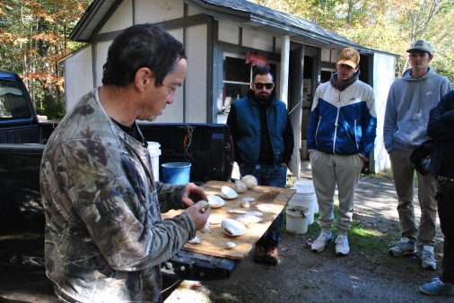 Students learn about shellfish species from a professional clammer